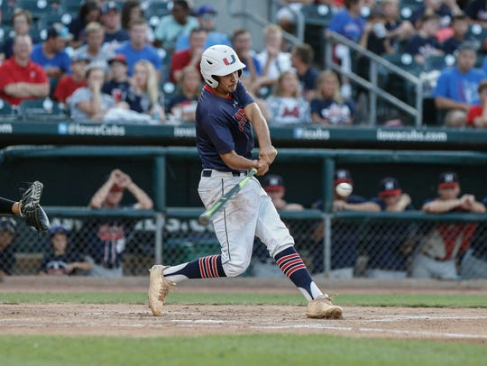 Urbandale senior Carter Troncin hits a home run in