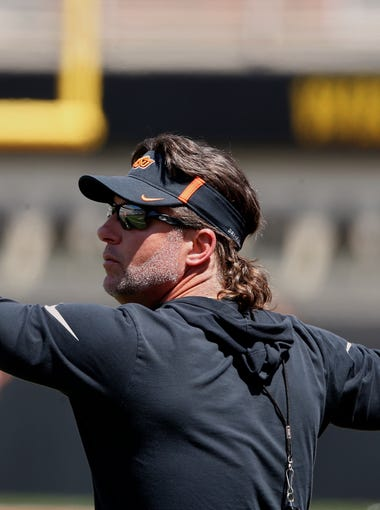 Oklahoma State head coach Mike Gundy gestures to his team during their spring game.