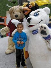 Adriano Youkhana poses for a picture with the Detroit Zoo's Zooperheroes and Beau the Bear from Beaumont Children's Hospital. Adriano was able to pick out a stuffed animal from the zoo, thanks to the zoo's donation of more than 200 stuffed animals to the hospital.