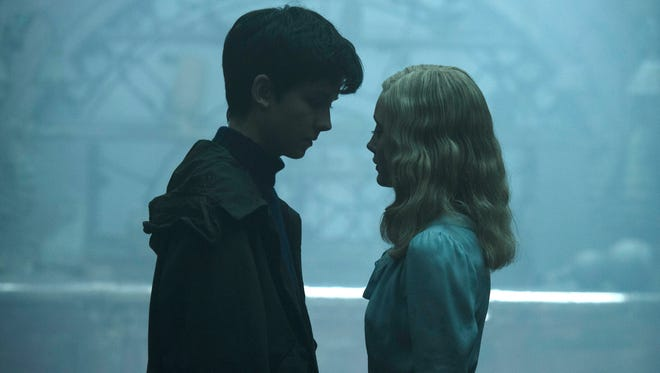 """Jake (Asa Butterfield) and Emma (Ella Purnell) grow close in """"Miss Peregrine's Home for Peculiar Children."""""""