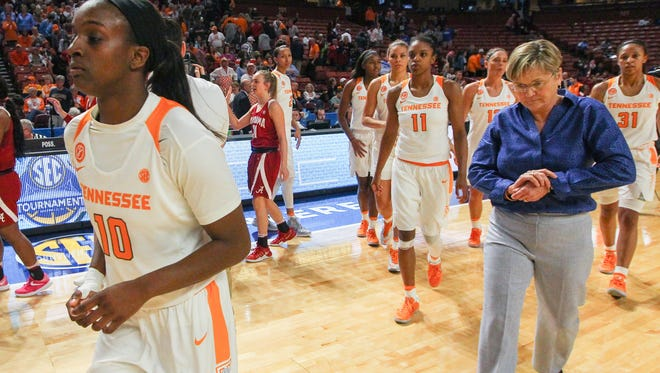 Tennessee guard Meme Jackson, left, guard Diamond DeShields, middle, and head coach Holly Warlick finish shaking hands with Alabama after losing 72-64 on Thursday in the SEC 2017 Women's Tournament game at Bon Secours Wellness Arena in Greenville.