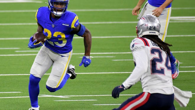 Los Angeles Rams running back Cam Akers (23) runs for a first down against the New England Patriots in the first half of an NFL football game in Inglewood, Calif., Thursday, Dec. 10, 2020. (Keith Birmingham/The Orange County Register via AP)