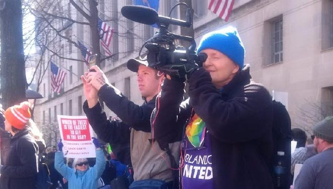 """Independent filmmaker Vicki Nantz is seen behind the camera during the March 24 """"March for Our Lives"""" rally in Washington, D.C., getting footage for her documentary """"Uprising: Pulse to Parkland."""""""