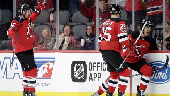 New Jersey Devils center Brian Boyle, right, celebrates