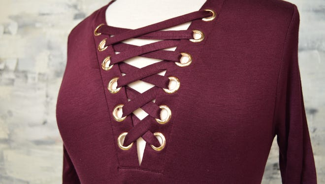Lace up tops continue to be in style. As the temperature drops, try a lace up sweater.