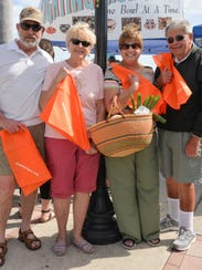 Dan Schneider, left, Sue Dorn and Chris and Ron Possell