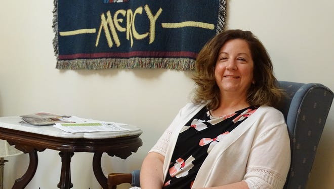 Sara McCoy, named new executive director at Our Lady of the Pines plans to use social media to promote the religious retreat center.