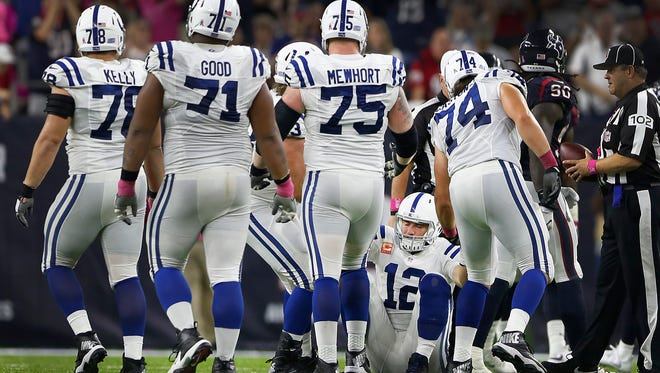 Indianapolis Colts quarterback Andrew Luck (12) is helped up off of the turf after getting sacked in overtime of their game against the Houston Texans  Sunday, Oct 16, 2016, evening at NRG Stadium in Houston TX.