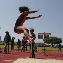 Beau Chene's Helena Tibbs long jumps during the 4A regional tack meet at the UL field April 27.