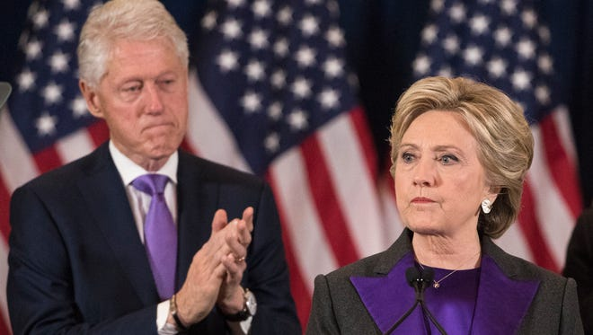 Former President Bill Clinton applauds as his wife, Democratic presidential candidate Hillary Clinton speaks in New York, Wednesday, Nov. 9, 2016, where she conceded her defeat to Republican Donald Trump after the hard-fought presidential election.