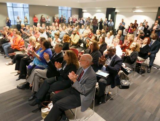 A crowd applauds Missouri Gov. Jay Nixon as he speaks