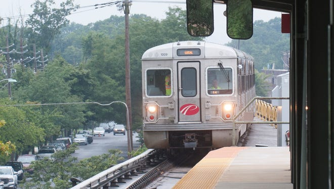 A PATCO Hi-Speedline train from Philadelphia arrives at the Collingwood station.