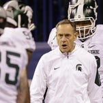Michigan State head coach Mark Dantonio watches his team warm up before the start of the Big Ten Conference championship NCAA college football game against Iowa on Dec. 5 in Indianapolis.