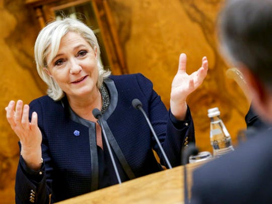 French far-right presidential candidate Marine Le Pen, left, gestures as she speaks to Vyacheslav Volodin, back to a camera, during their meeting in the Lower House of the Russian Parliament in Moscow, Russia, Friday, March 24, 2017. Le Pen has made multiple visits to Russia, as have her father, niece and other members of the National Front, often meeting with Russian legislators.