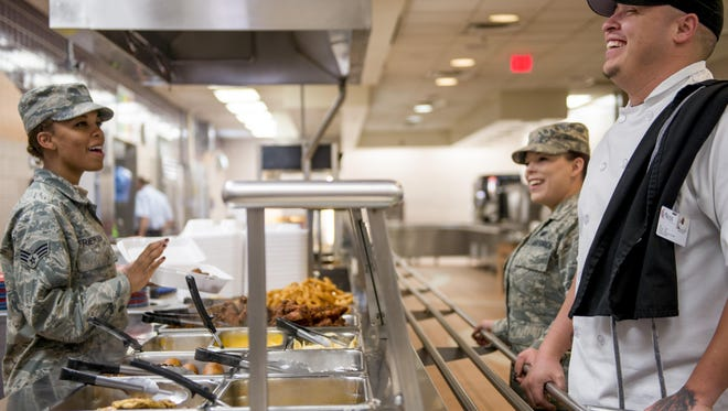 Senior Airman Mercedes Frierson, a 49th Force Support Squadron food service specialist, serves a joke to customers inside the Shifting Sands Dining Facility at Holloman Air Force Base on March 24. Humor helps keep the team inside the dining facility entertained as they perform their mission-critical task of feeding the operational force at Holloman.