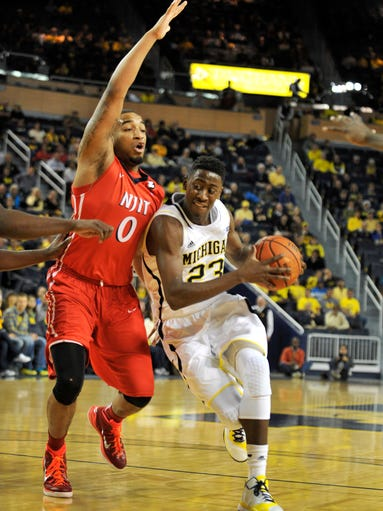 NJIT guard Ky Howard defends Michigan guard Caris LeVert