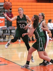 Madison's Brooklyn Arnold keeps the ball in play during Thursday's Ohio Cardinal Conference game at Ashland.