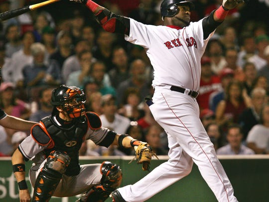 Boston's David Ortiz watches the flight of his home run during the Red Sox championship season.