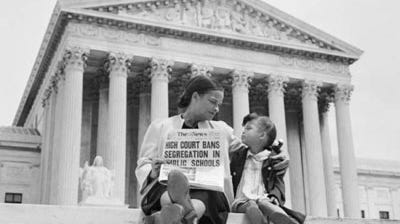 On the steps of the U.S. Supreme Court, Nettie Hunt explains to her daughter, Nickie, the meaning of the high court's ruling in Brown v. Board of Education.