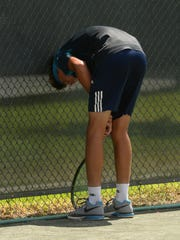 Jacob Bullard of So. Cal. takes a moment after missing a shot during the final day of play of the USTA Intersectional Tennis 16s at Pierremont Oaks Tennis Club.