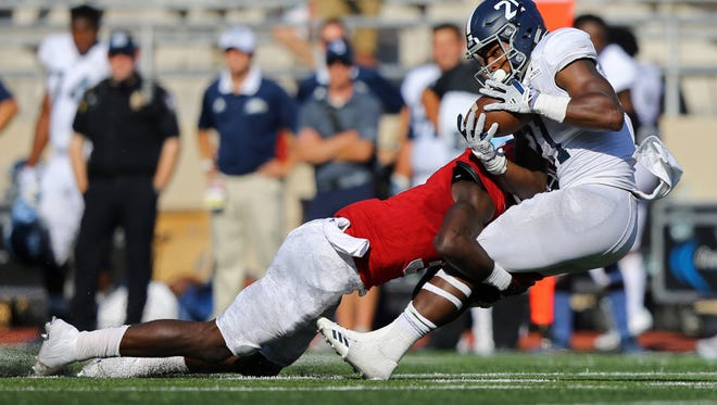 Indiana linebacker Tegray Scales tackled Georgia Southern Eagles running back Wesley Fields in a game on Sept. 23.