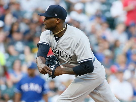New York Yankees starting pitcher Domingo German (65) throws a pitch in the first inning against the Texas Rangers at Globe Life Park in Arlington on Tuesday, May 22, 2018.