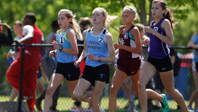 Lansing Catholic's Olivia Theis (2) and Jaden Theis (1) compete in the 3,200-meter run in the MHSAA Division 2 track and field finals, Saturday, June 2, 2018, in Zeeland, Mich. Olivia and Jaden placed first and second, respectively.