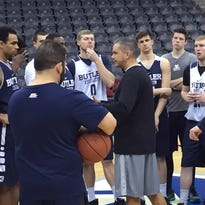 Coach Chris Holtmann, center, speaks to the  Butler Bulldogs after shootaround.
