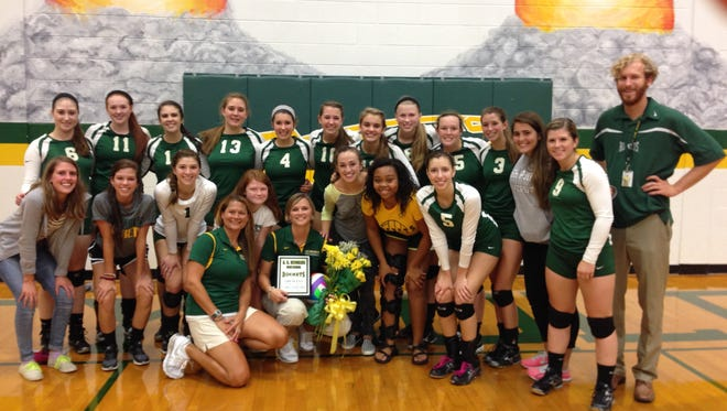 Reynolds volleyball players pose for a picture with coach Lori Ledford after her 100th career win on Thursday night.