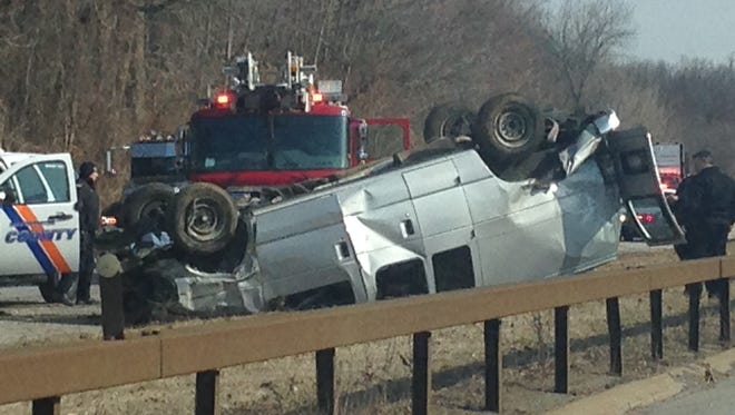 A van flipped over during an accident Wednesday, March 26, 2014, on the southbound Hutchinson River Parkway in White Plains, south of the gas station. No one was injured.  (