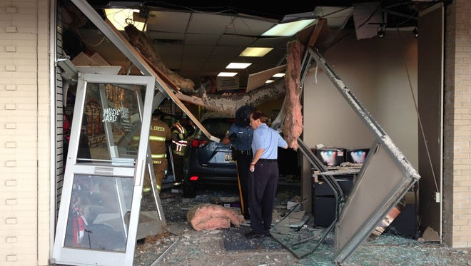 Car went through front of Music & Arts store at Midway Shopping Center.