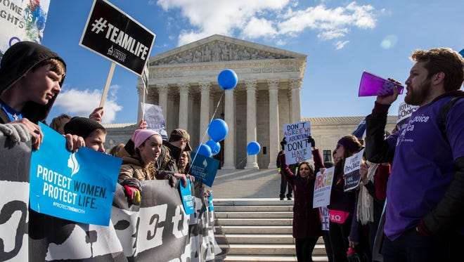 Abortion rights supporters and opponents rally outside the Supreme Court on March 2, 2016, when oral arguments were heard in a Texas abortion case.