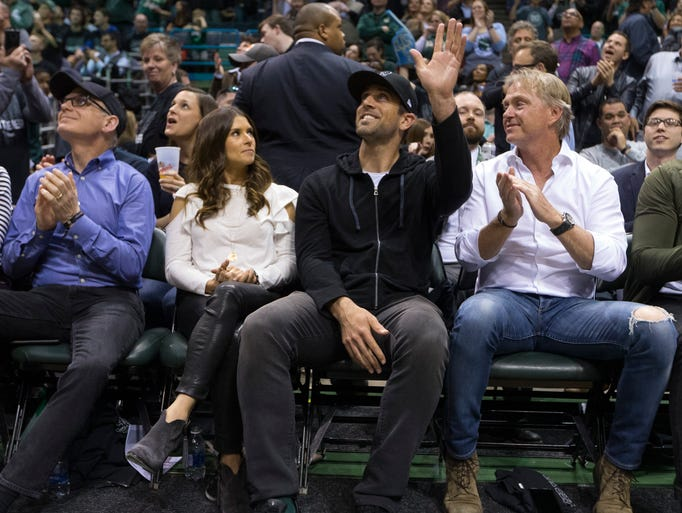 Green Bay Packers quarterback Aaron Rodgers waves to
