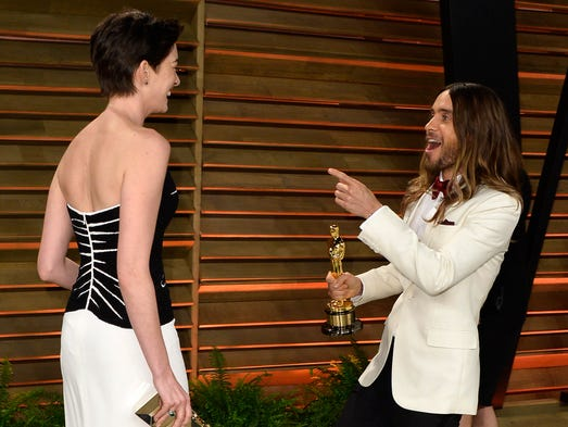 The awards have been given out and now, it's time to celebrate. Here, two Oscar winners (but not in the same year) let loose at Vanity Fair: Jared Leto and Anne Hathaway.