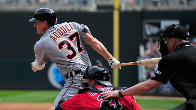 Jim Adduci of the Tigers hits a two-run double as Jason Castro of the Minnesota Twins catches the game during the third inning April 23, 2017 at Target Field in Minneapolis.