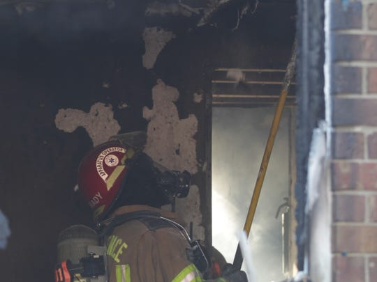 A firefighter works at the scene of a blaze in Florence