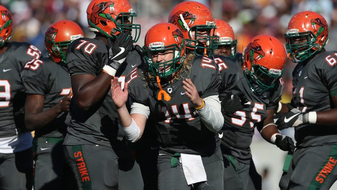 FAMU's Ryan Stanley breaks the huddle with his team against Bethune-Cookman during the Florida Classic at Camping World Stadium in Orlando on Saturday.