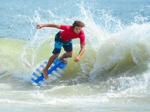 Mason Broussard, Gulf Shores, AL, catches a wave during