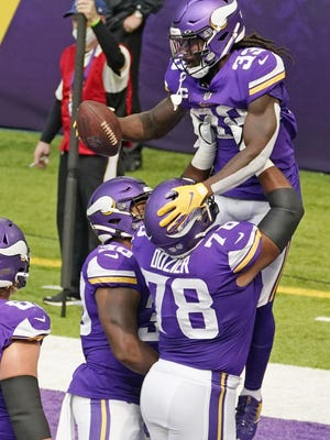 Minnesota Vikings running back Dalvin Cook (33) is hoisted by teammates after a touchdown against the Green Bay Packers on Sunday, Sept. 13, in Minneapolis.The Associated Press' Pro Picks selects the Vikings as an upset special against the Indianapolis Colts on Sunday.