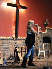 Chelsea Musick performs during the fundraising concert for the Coyle family.