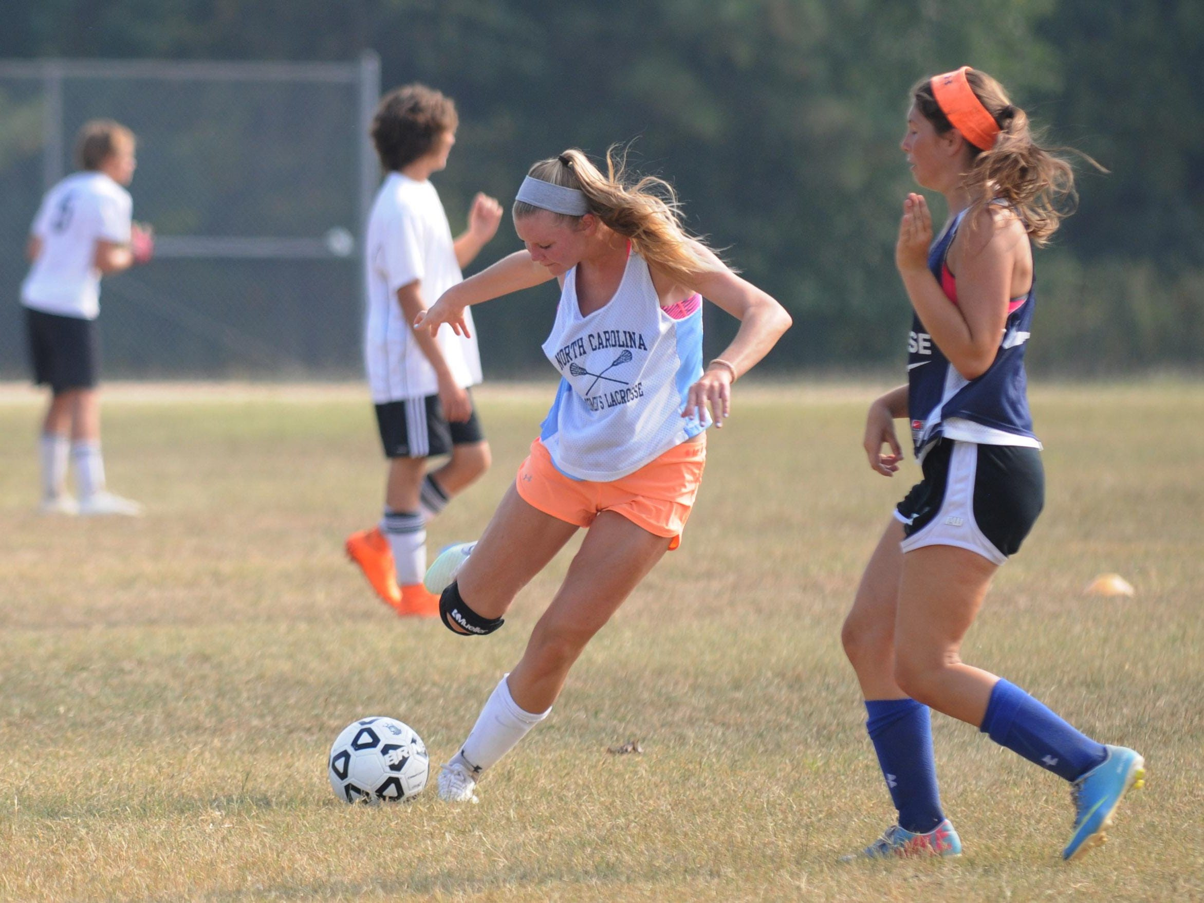 Stephen Decatur's Lexie VanKirk crosses a ball during practice. VanKirk will be an offensive threat this season.