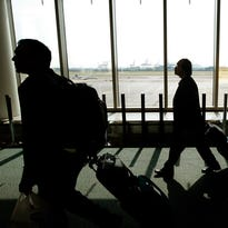 Travelers with bags walk toward the passport control line upon arriving to Newark International Airport on Au. 24, 2009, in Newark, New Jersey.