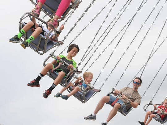 Fairgoers ride the giant swing at the Waukesha County Fair in Waukesha.