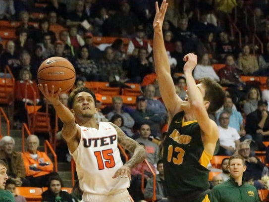UTEP's Kobe Magee, 15, drives for a layup but is rejected