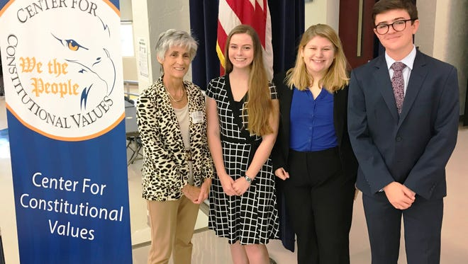 Center for Constitutional Values Chair Kate Boland, left, third-place winner Rebecca Cameron of South Fork High School; second-place winner Tabitha Bean of Jensen Beach High School and first-place winner Sam Crombie of Martin County High School at the Constitution Academic Competition.