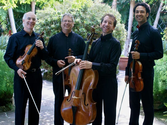 For more than half a century the Fine Arts Quartet has been the resident string quartet at UW-Milwaukee. Members are: Ralph Evans, violin; Efim Boico, violin; Robert Cohen, cello; and Juan-Miguel Hernandez, viola.