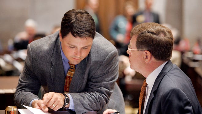 Joe McCord, left, talks with  Rep. Mike McDonald, D-Portland, in 2007. House Speaker Beth Harwell announced McCord's departure as House Clerk on Thursday, January 5, 2017.