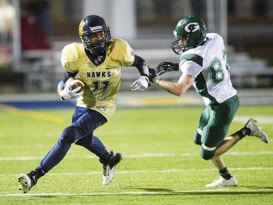 Decatur Central's Tyrone Tracy in action.