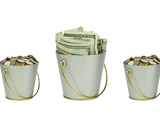 Four buckets with money