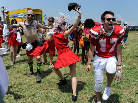 Willy Appleman of NY dances during the kick off parade at Bonnaroo Music and Arts Festival on Thursday  June 11, 2015.